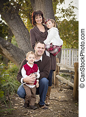 Young Attractive Parents and Children Portrait in Park