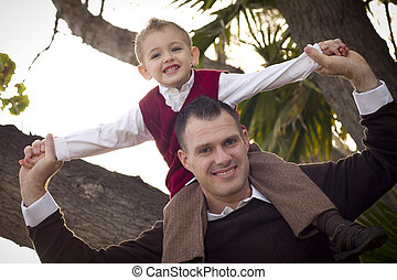 Handsome Father and Son in the Park - Young Laughing Father...
