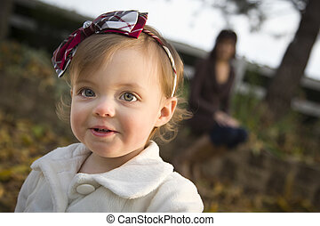 Adorable Baby Girl Playing in Park with Mom