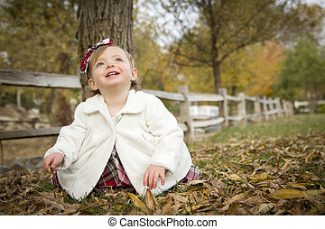 Adorable Baby Girl Playing in Park - Adorable Baby Girl...