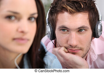 man with headphones beholding his belle