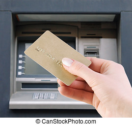 withdraw money from the credit card - hand with the credit...