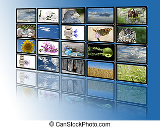 Monitors with relaxing images. - A group of monitors with...