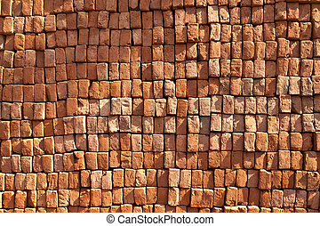 red stapled bricks give a harmonic pattern in the sun