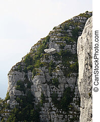 enormous rock Boulder balanced on a ravine and is going to fall