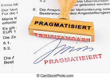 wooden stamp on the document: pragmatized - a stamp made of...