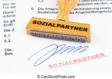 wooden stamp on the document: the social partners