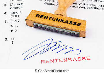 wooden stamp on the document: retirement fund - a stamp made...