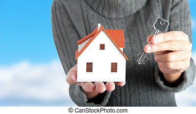 Buy a house - Girl holding a house with the key