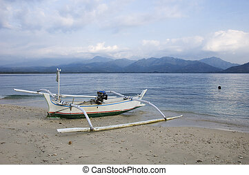 Pump boat and view of Lombok island from Gili Air, Indonesia...