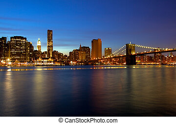 Brooklyn Bridge and Manhattan - Sunset view of Brooklyn...