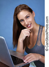 Pretty girl in trade fair on laptop - Beautiful young woman...