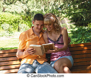 couple sitting on a park bench