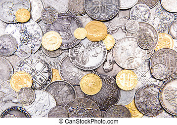 Old coins background - Old gold and silver coins background,...