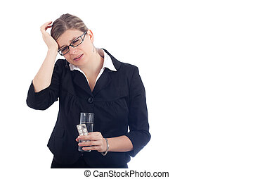 Unhappy young woman with headache holding glass with water...