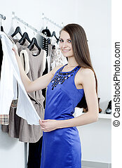 young woman in mall buying clothes - young Beautiful woman...