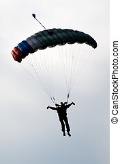 Parachute Silhouette - silhouette of man ready for landing...
