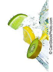 fruit splashing - sliced citrus fruit with kiwi splashing...