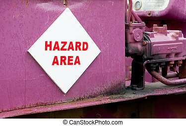 Hazard sign - Hazard sign on abandoned pink bulldozer