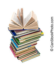 open book on a pile of books on white background
