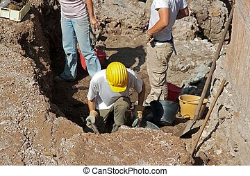 archaeologica excavations - scientists conducting...