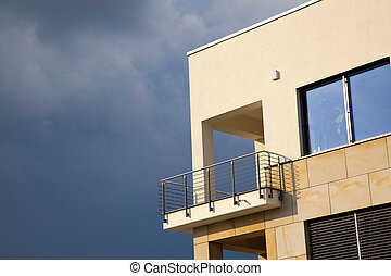 balcony of modern flat with dark clouds in rain