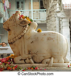 Sculpture of Nandi ( bull ) in front of hindu temple,...