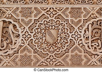 Arabic stone engravings on the Alhambra palace wall in...