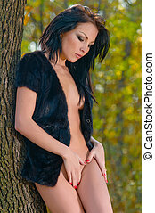 natural nude beauty posing outside in the nature in autumn