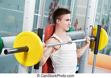 bodybuilder man doing biceps muscle exercises