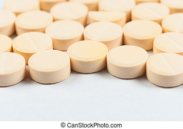 Texture of medical pills on white background
