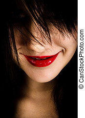 Closeup photo of a girl with a grin on her face