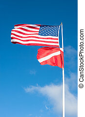American and scuba flag blowing in wind