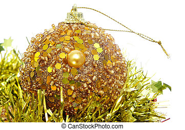 christmas ball - a shiny golden christmas ball and tinsel on...