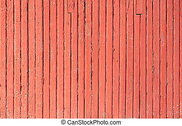 An old worn barn or antique wooden fence with chipped red...