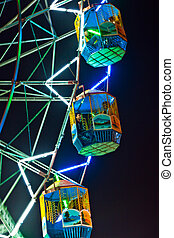 people enjoy the big wheel in the amusement park in Delhi in...