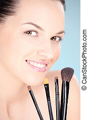 woman holding set of make up brushes - Pretty woman holding...