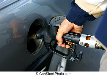 fill up of gasoline - Hand fill up of gasoline