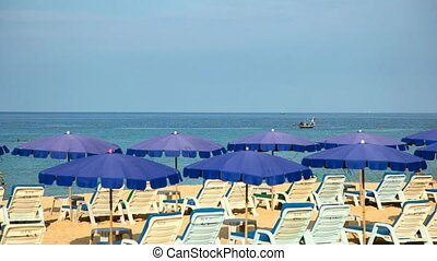 Beach. - Sandy beach with Loungers and Umbrellas.