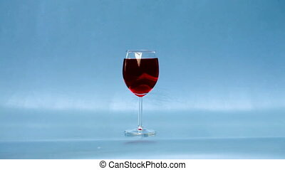 Breaking glass with wine,  smash into