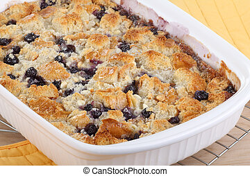 Baked Blueberry Cobbler - Baked blueberry cobbler in a...