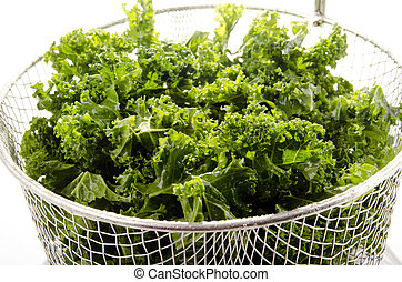 Washed and sliced curly kale in a colander