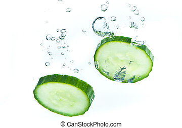 cucumber in water - sliced cucumber splashing water isolated...
