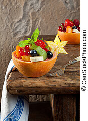 Fruit salad on vintage table - vintage table and colorful...