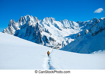 Hikers in winter mountains - Extreme Sport. Lone hikers in...