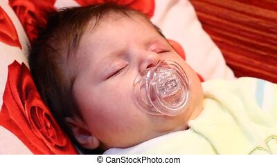 Face of adorable baby with pacifier