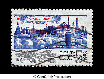 USSR - CIRCA 1987: cancelled stamp printed in the USSR, shows Kremlin with red star, trees under snow for New Year, circa 1987. Happy New Year 1988 as text.