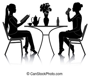 two girls at a table in a cafe - silhouettes of two girls at...