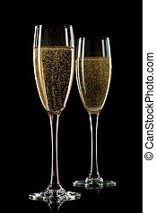 Glass of champagne, isolated on a black - A glass of...