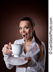 funny Woman with cup of coffee smile at brown